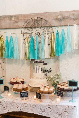 blue, white and gold themed wedding reception dessert table