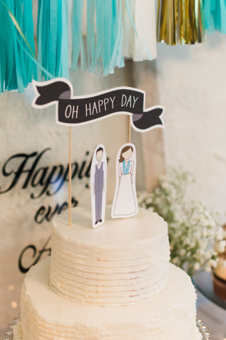 "2 layer white cake with ""oh happy day"" and bride and groom on top"