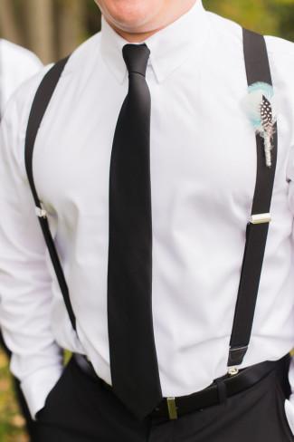 Groomsmen wearing suspenders, skinny blacktie and feather boutonniere