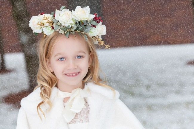 Flower girl wearing flower crown with white roses