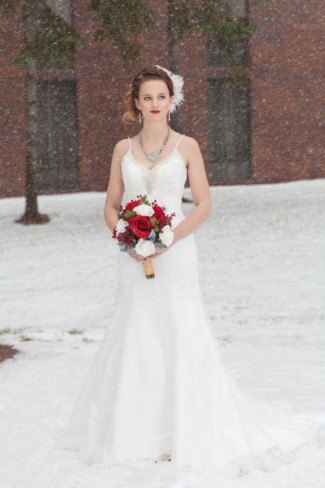 Bride wearing a spaghetti strap gown and red lip stick