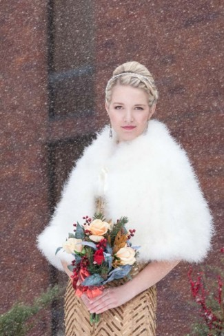Maid of honor wearing high bun, gold dress and fur stole