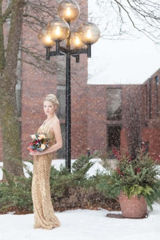 maid of honor wearing gold dress standing in the snow