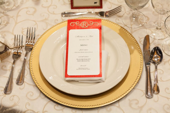 Winter Wedding reception with gold charger, white plate and red sparkle munu