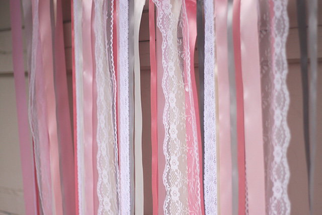 Pink, grey, white, lace ribbon hanging for ceremony backdrop