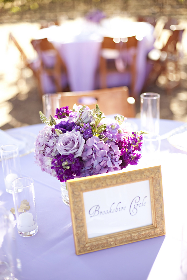 purple flowers in wedding center piece