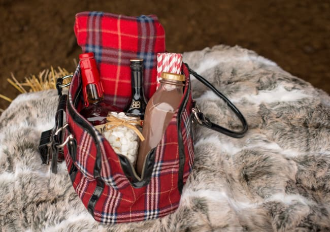 plaid bag on a fur throw with ingredients for hot chocolate mix