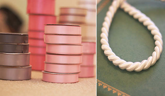 Stack of pink and grey ribbon and a white cord