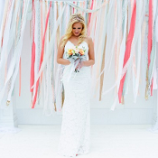 bride standing infront of colorful background