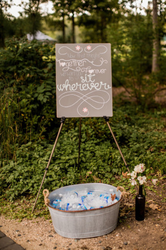 easel holding seating sign for wedding at morning glory farms