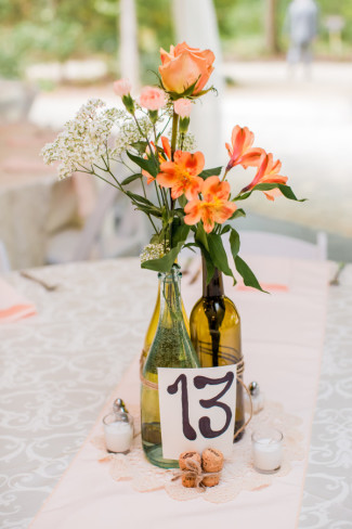 table number wine bottle with peach roses