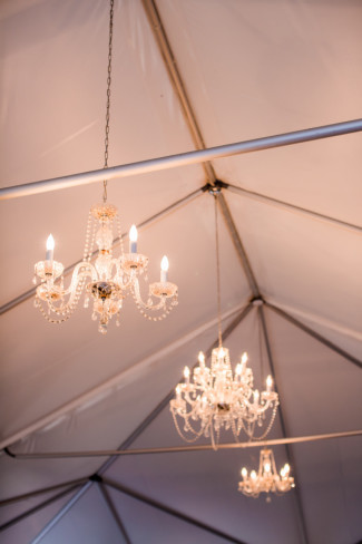 chandeliers hanging from canopy tent