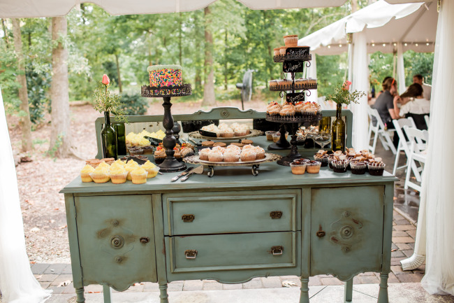 vintage table with cupcakes and candy outdoors