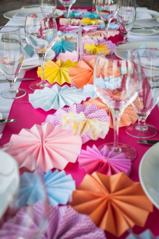 colorful pinwheels and pink tablerunner