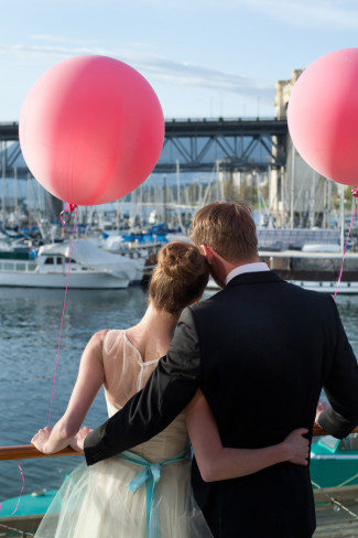 pink geronimo balloons with Burrard Bridge in background