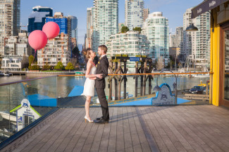 standing on Bridges Restaurant outdoor patio with False Creek harbor in background