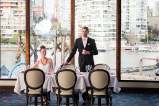 Couple sit at whimsical Vancouver styled wedding shoot at Bridges Restaurant