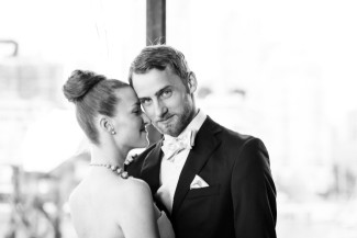 black and white photo of bride and groom's faces