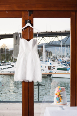 dress hanging on door with cake on table at Bridges Restaurant