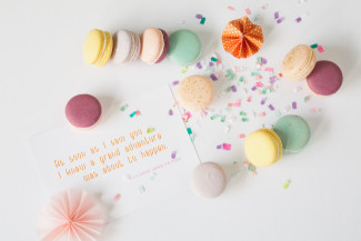 colorful macaroons and wedding stationery