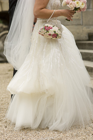 Bride wearing Monique Lhuillier gown walking up to church in Paris for wedding ceremony