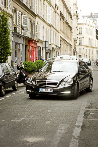 Mercedes driving through streets of Paris for wedding party