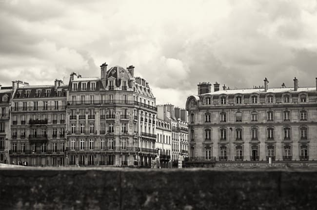 Black and white photo of a city block and buildings in Paris France