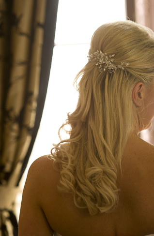 blonde bride wearing floral crystal hair clip in her hair