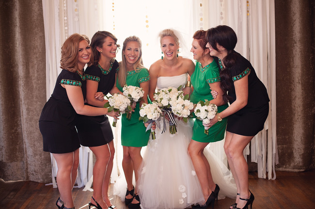 21 bride with bridesmaids in black and green