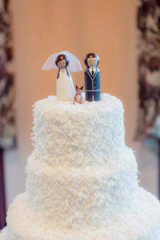 35 coconut covered wedding cake with 2 wooden bride and groom cake toppers with dog