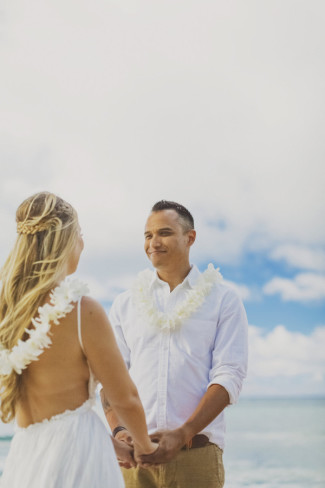 bide and groom with white orchid leis
