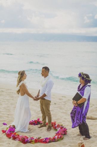 officiant and couple on sandy ironwoods beach for wedding ceremony