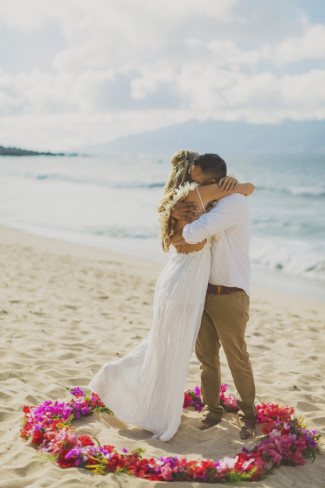 bride and groom embrace, just married on Ironwoods Beach