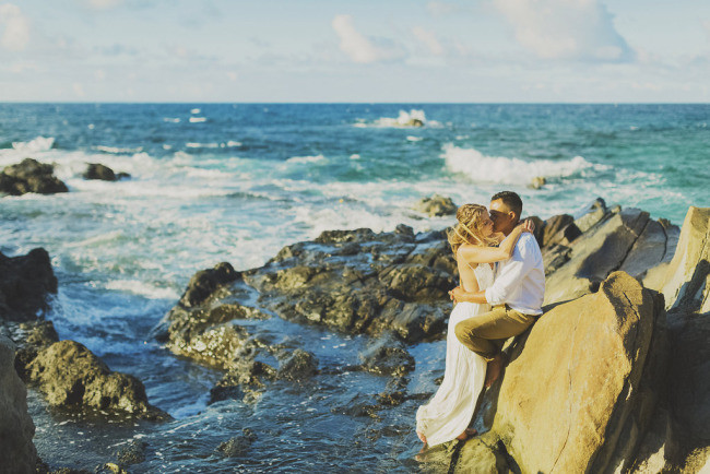passionate kiss on rocks