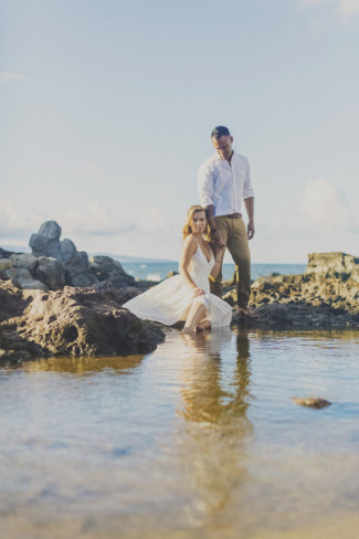 Newlywed couple in wading pool at Ironwoods Beach