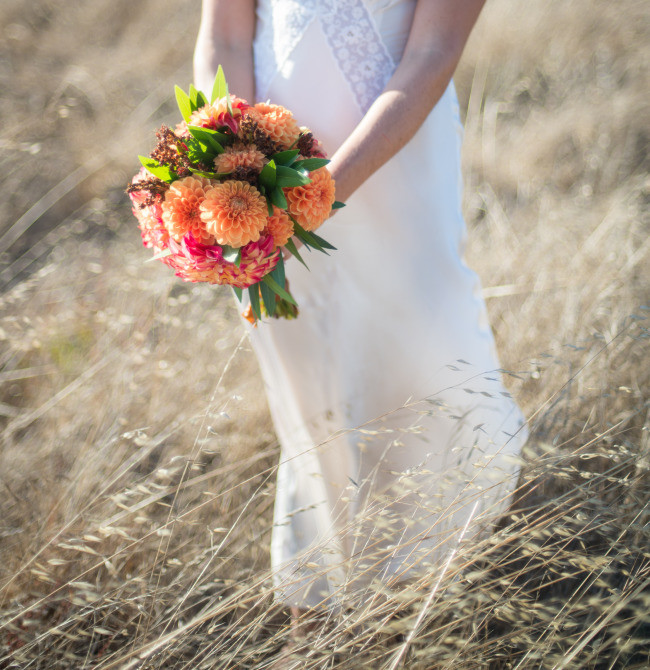 close up photo of bridal bouquet with peach honeycomb dahlias