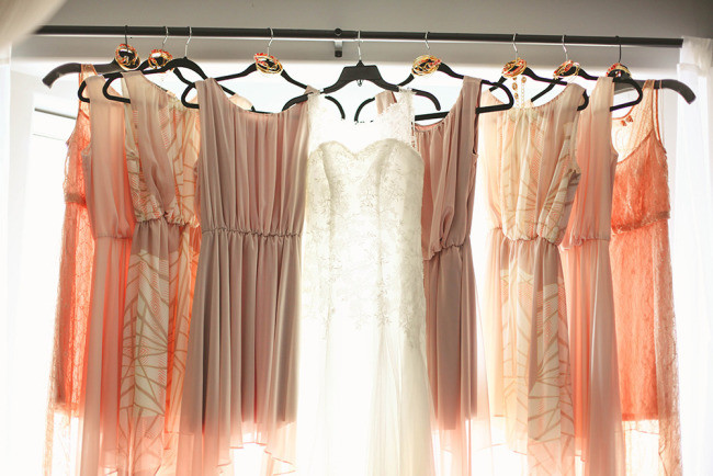 Mismatched bridesmaids dresses in pink and peach colors