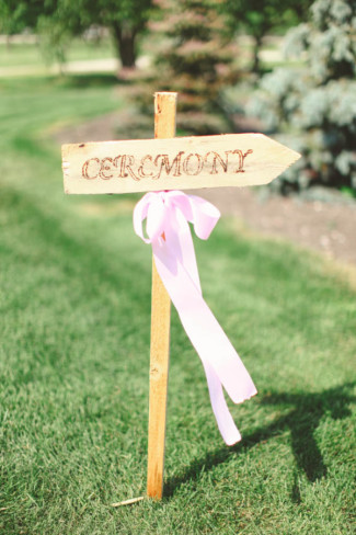 wooden ceremony sign with ribbon