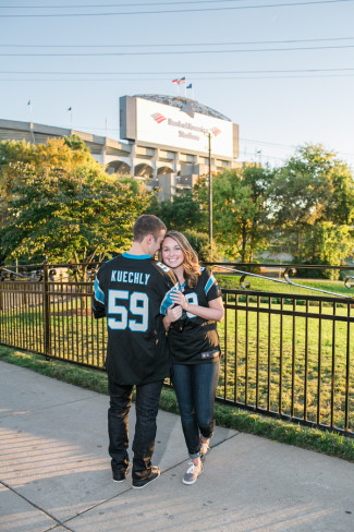 Couple standing outside Panthers stadium for engagement shoot