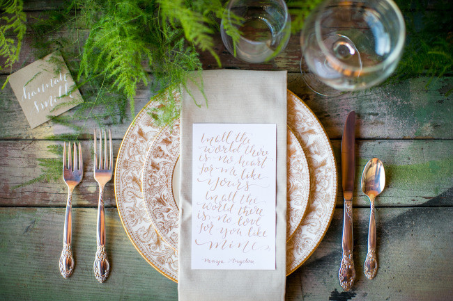 Rustic wood table and rustic place setting with gold plates