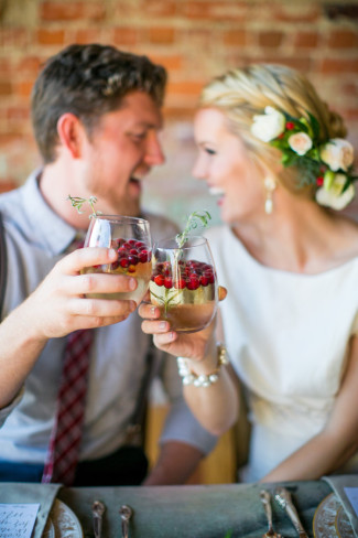 bride and groom toast with sangria