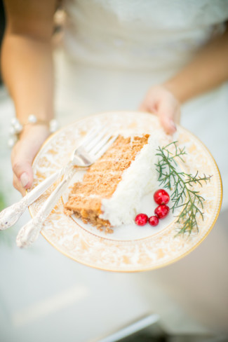 Bride holding a plate with a slice of cake made by Katie's Cakes