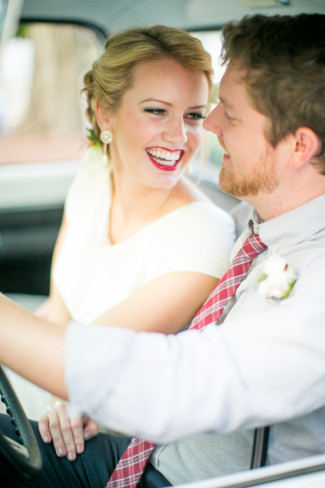 Bride and groom sitting in a vintage truck