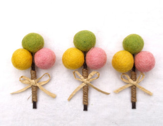 green, yellow, and pink billy ball felt boutonnieres