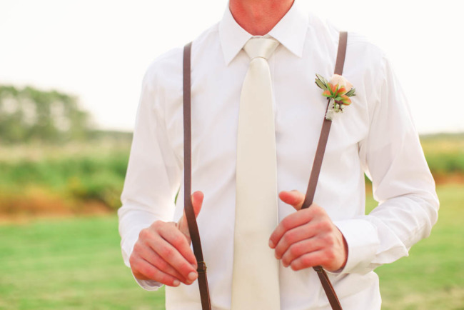 Groomsmen wearing white shirt cream tie and brown suspenders