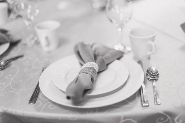 Wedding reception place setting with burlap napkin ring