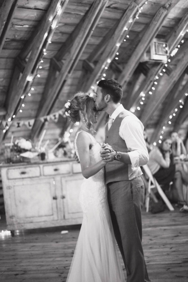 Bride and groom dancing during wedding ceremony at The Rustic Wedding Barn
