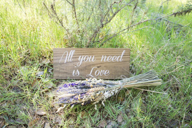 "Rustic wooden ""All you need is love"" sign made by Sweet NC Collective on Etsy"