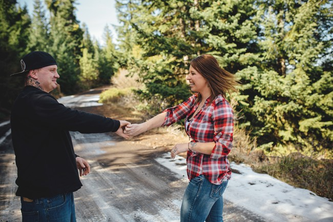 Couple dancing in the forest in Oregon for engagement session