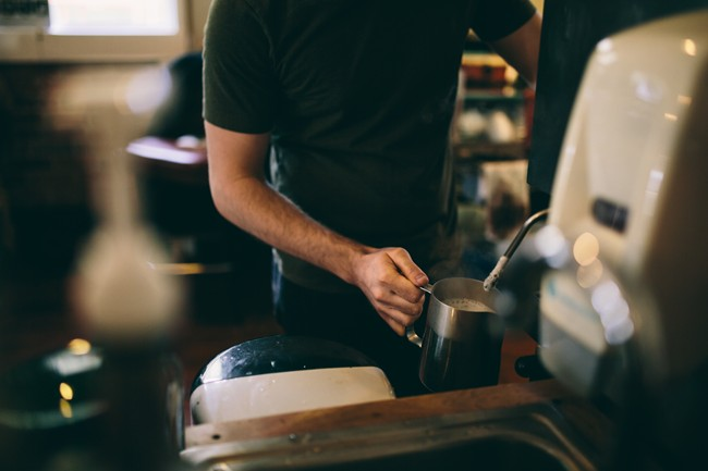 Barista making coffee at Gathering Grounds Cafe in Oregon